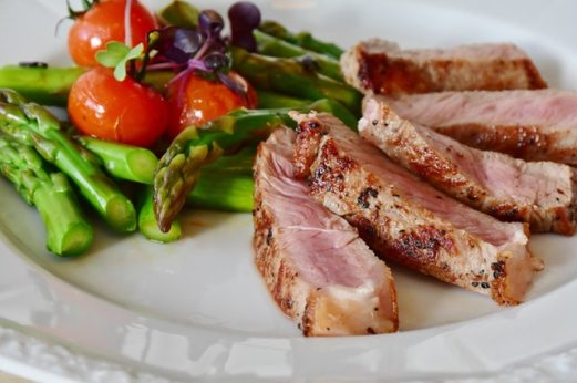 Grilled Asparagus & Cherry Tomatoes with Grilled Steak on white plate