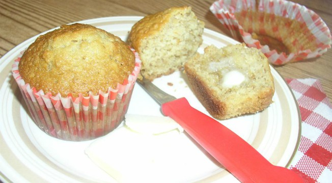 Oatmeal Muffins on a plate with butter and a red and white gingham napkin